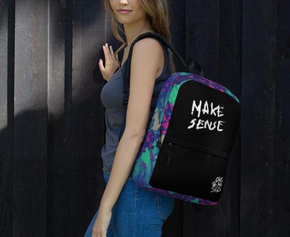 Model wearing MAKE SENSE Backpack - Side B