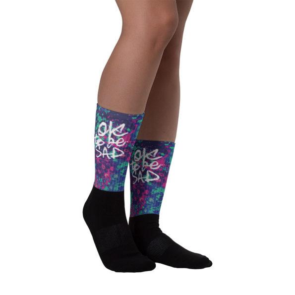 Model wearing OTBS Trippy Winter Socks - Side B